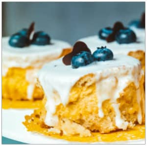 Desserts on a plate with blueberries on top by Brina Blum on Unsplash