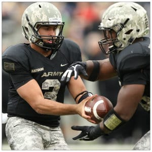 Two Army West Point Football players in a game