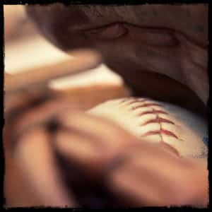 baseball sitting inside a mitt- image by jon eckert www.unsplash.com