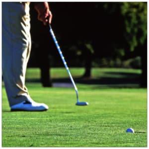 golfer putting on a green