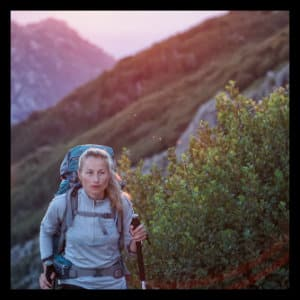 Woman hiking a mountain at sunset - photo by lucas-favre-181312 www.unsplash.com