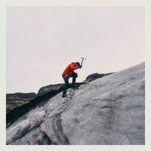 man ice climbing on a mountain - image by Jared Erondu on www.unsplash.com