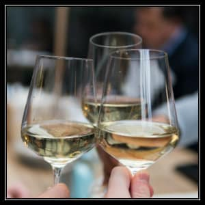 Three small glasses of white wine held up together - image by matthieu-joannon unsplash.com