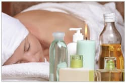 woman on a massage table with products nearby