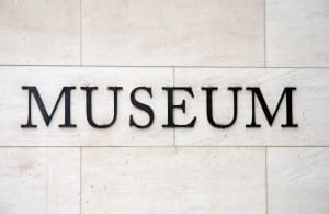 Marble wall with the words Museum in black letters
