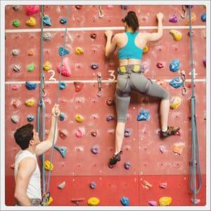 Girl climbing on an indoor rock wall
