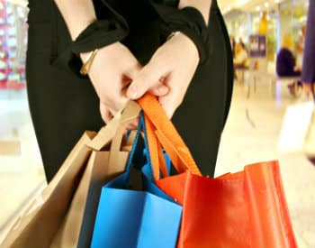 woman holding shopping bags in her hands