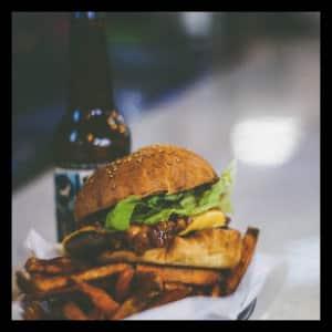 Hamburger with fries and a beer - image by yanko peyankov unsplash.com
