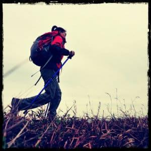 woman hiking along a ridge